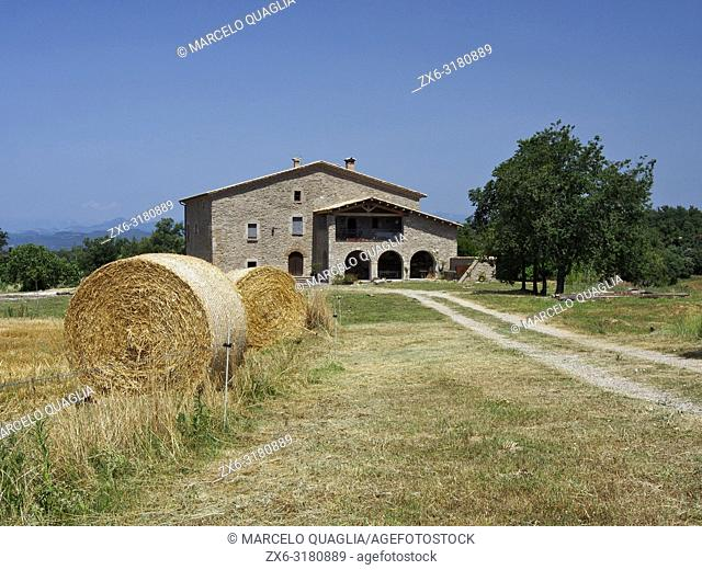 Typical farmhouse of Catalonia (Masia) with hay bales at Olost village countryside. Lluçanès region. Barcelona province, Catalonia, Spain
