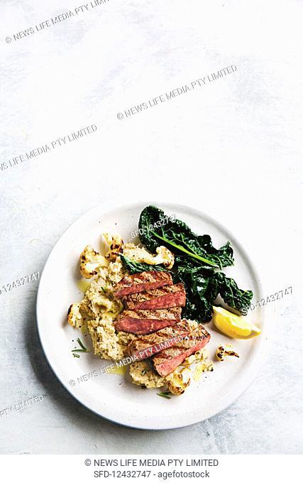 Grilled steak with smoky cauliflower and white bean mash