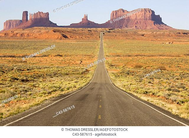 One of the most famous images of the Monument Valley is the long straight road (US 163) leading across flat desert towards sandstone buttes and pinnacles of...