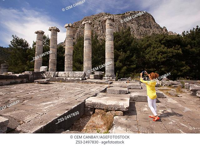 Tourist taking photos at the Temple of Athena, the ancient city of Priene, Aydin Province, Turkey, Europe