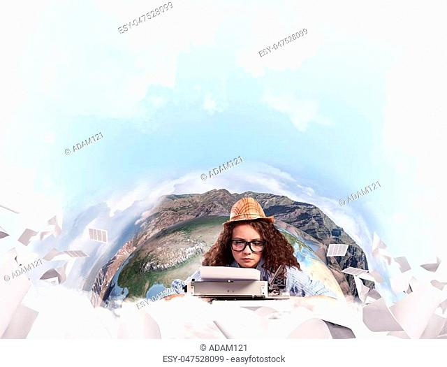Hard-working female writer using typing machine while sitting at the table with flying papers and Earth globe among cloudy skyscape on background