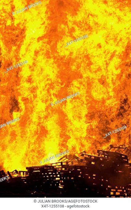 Burning wooden pallets to make a huge bonfire