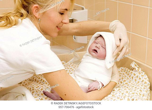 People - nursing sister showing new born baby girl