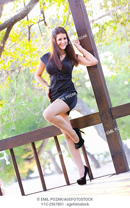 Teen girl happy balancing on one leg outdoors