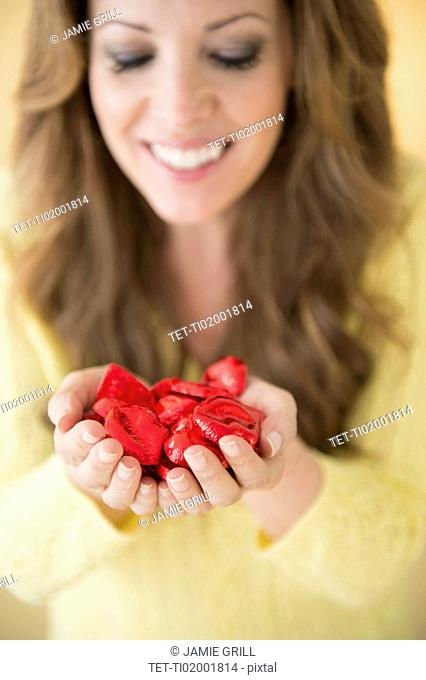 Woman holding chocolates in cupped hands
