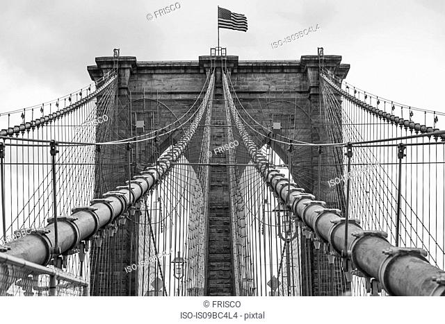 View of American flag on Brooklyn Bridge, B&W, New York, USA