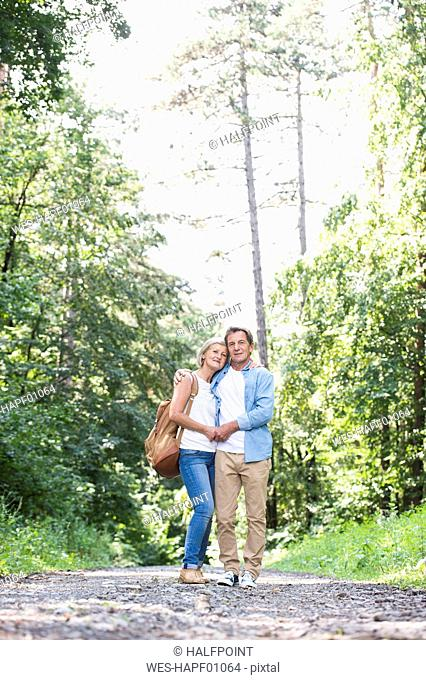 Happy senior couple relaxing together in the woods