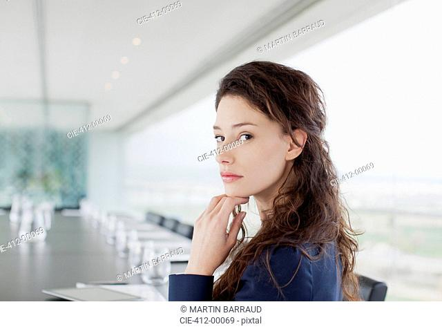 Portrait of serious businesswoman in conference room