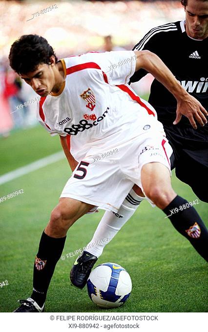 Perotti (Sevilla) pursued by Gago (Real Madrid). Spanish Liga football game between Sevilla FC and Real Madrid CF that took place at Sanchez Pizjuan stadium