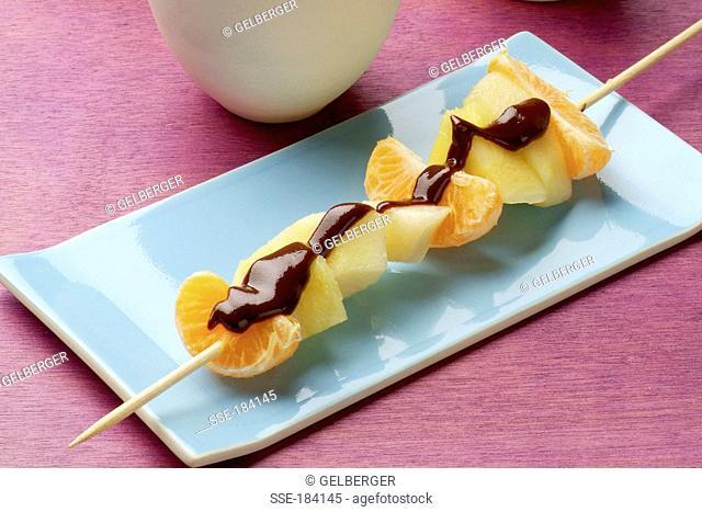Fresh fruit brochette with chocolate sauce
