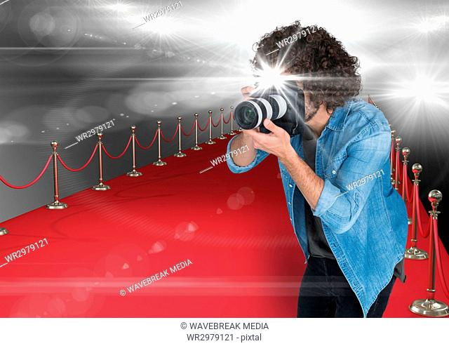 photographer taking a photo with flash in the red carpet. Flares everywhere