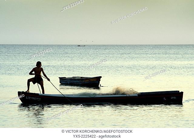 Fisherman preparing fishing net on a small boat near Farallon village, Cocle Province, Panama