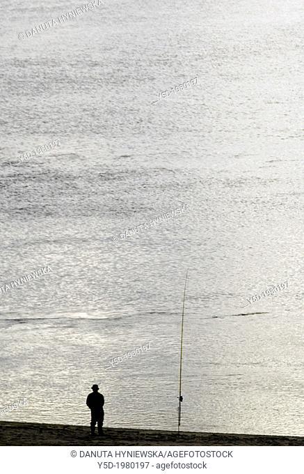 man fishing with a rod in lagoon, Foz do Arelho, Leira , Silver Coast , Portugal