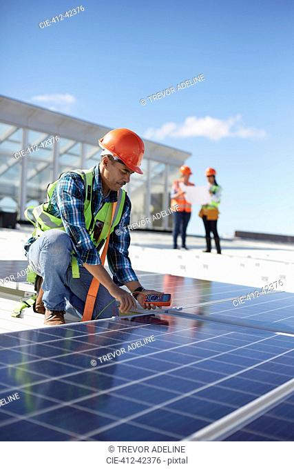 Engineer testing solar panel at power plant