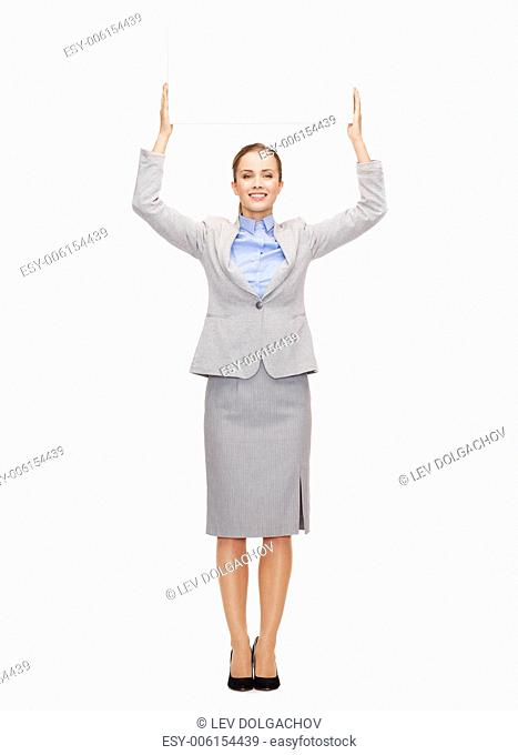 business, office and advertisement concept - smiling businesswoman with white blank board over head