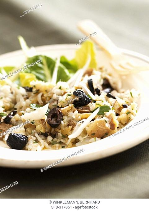 Cod and potato dish with black olives