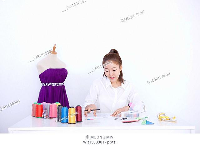 a clothing designer working on a project