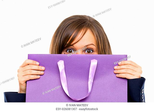 Businesswoman opening purple present with surprise isolated on white background