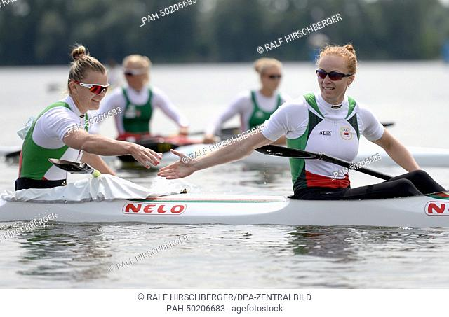 White Russian Marharyta Zischkewitsch (R) and Marina Litwintschuk cheer after their victory title in the canoe double over 200 meters during the European...