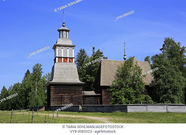 Old wooden church of Petajavesi, Finland, UNESCO World Heritage site, and surrounding field on a sunny day of summer. The church was built 1763-65
