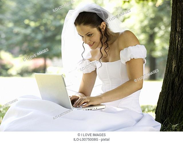A bride using a laptop