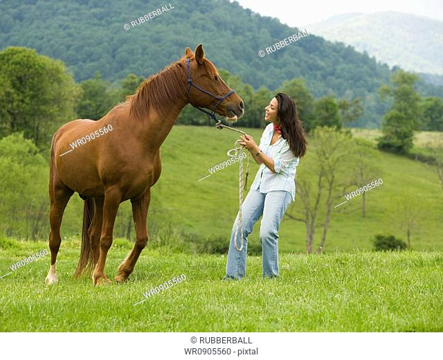 woman holding the reins of a horse