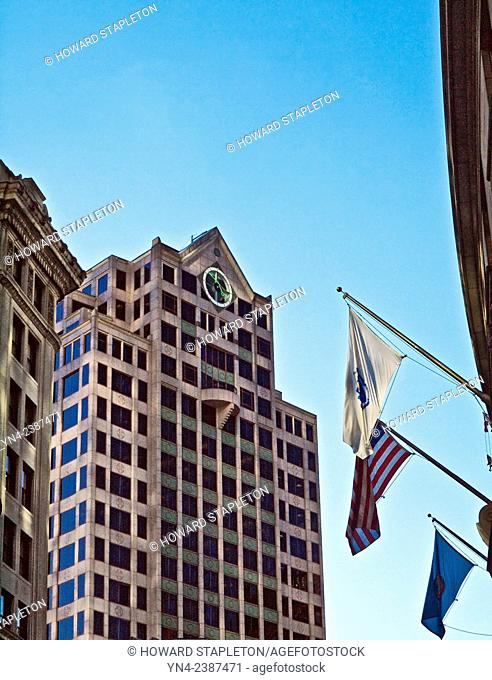 Buildings and flags in downtown Boston, Massachusetts. Center building location is 101 Arch street. It stands 21 stories high and was buil in 1988
