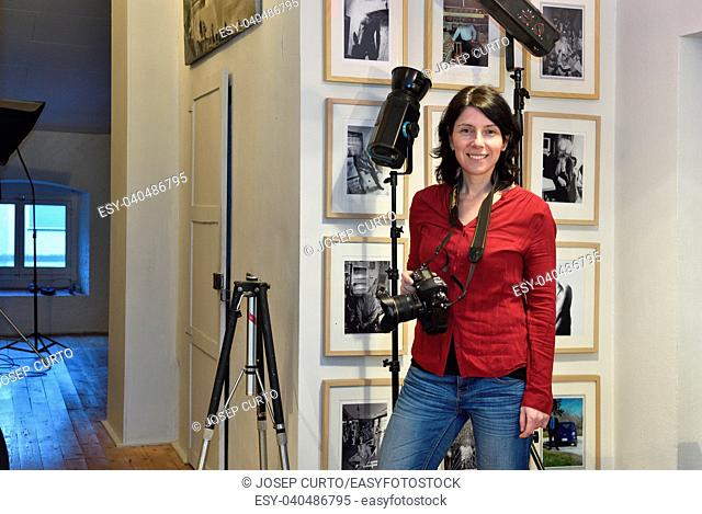 woman photographer in her photography studio