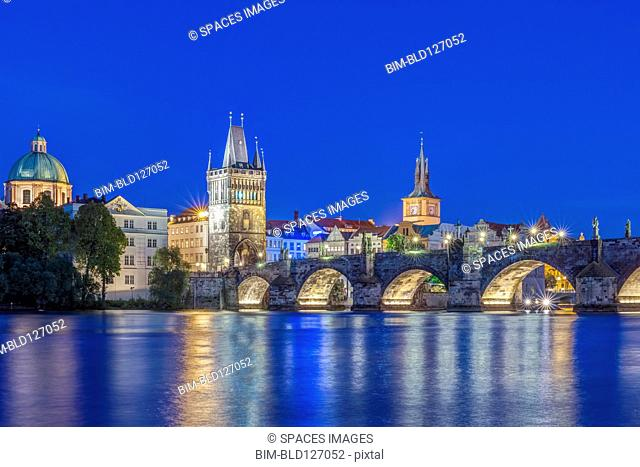 Charles Bridge and city illuminated at dusk, Prague, Czech Republic