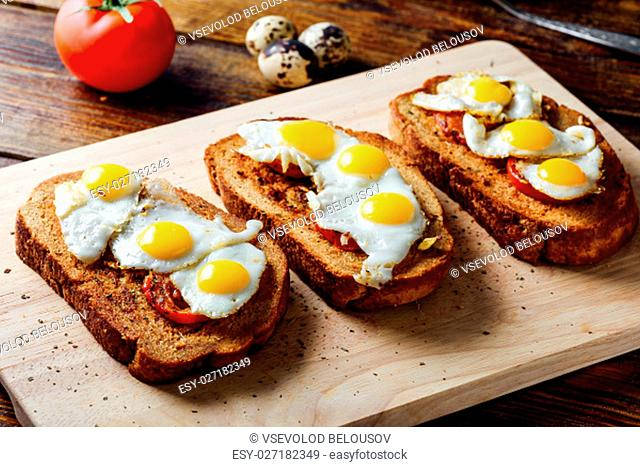 Bruschettas with Sun Dried Tomatoes and Fried Eggs