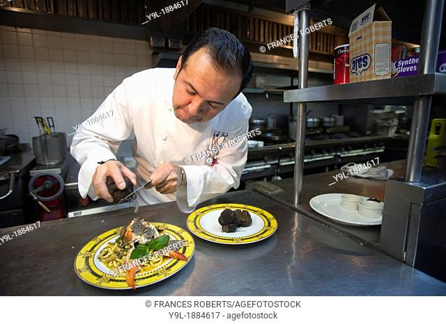 Chef prepares the lobster and winter black truffle dish featured in the Bice Ristorante four course prix fixe menu costing $2013 served on Gianni Versace 'Bice...
