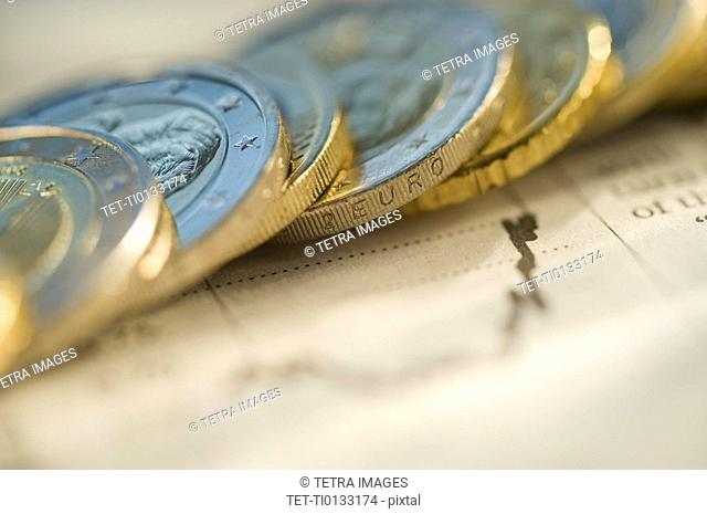 Euro coins on financial graph