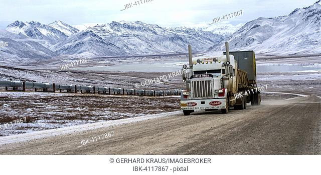 Dalton Highway, Trans-Alaska Pipeline System TAPS on the left, Brooks Range behind, Alaska, USA