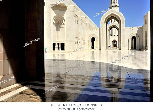The courtyard of the Sultan Qaboos Grand Mosque in Muscat, Oman