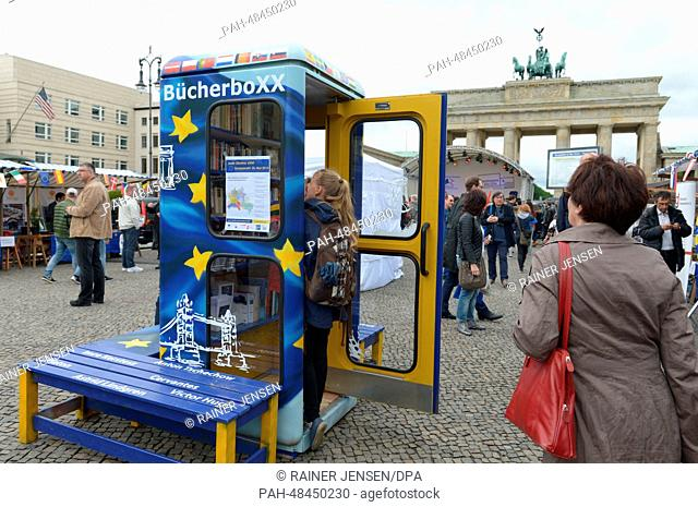 A person visits the Book Box during the Europafest at the Brandenburg Gate in Berlin, Germany, 09 May 2014. It is the 64th birthday of the European Union and...