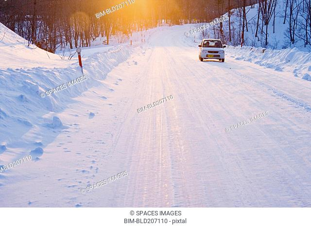 Car on Snow Covered Road