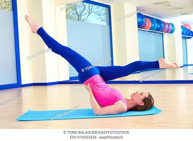 Pilates woman scissor exercise workout at gym indoor