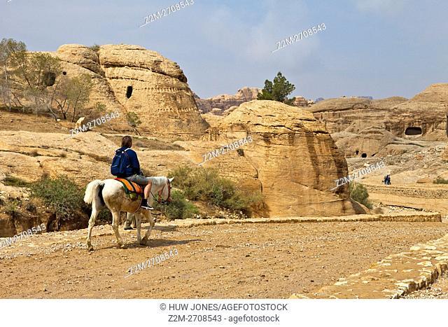 Man on horseback approaching the Al-Siq, Wadi Musa, Petra, Jordan, Western Asia
