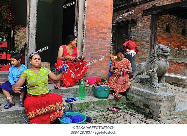 At the corner of the street in Baktapur, Many women knitting on the street