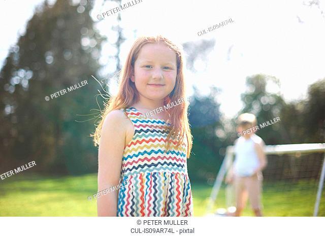 Portrait of young girl in garden