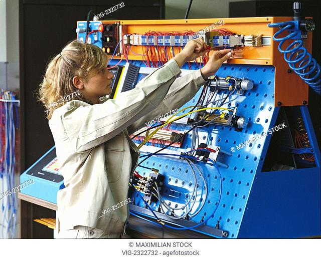 FEMALE TRAINEE AT A TEST SET-UP FOR CONTROL ENGINEERING - 01/01/2010