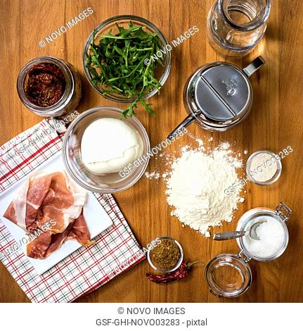 Ingredients on Wood Table in Kitchen, High Angle View