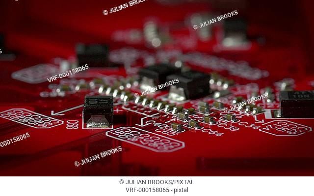 slow flight over electronic circuit board, red, shallow DOF