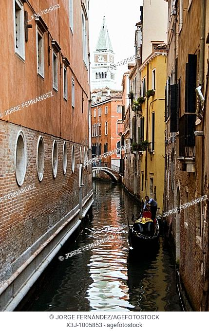 Canals of Venice, gondola and the Campanile in view, Venice, Italy, Europe