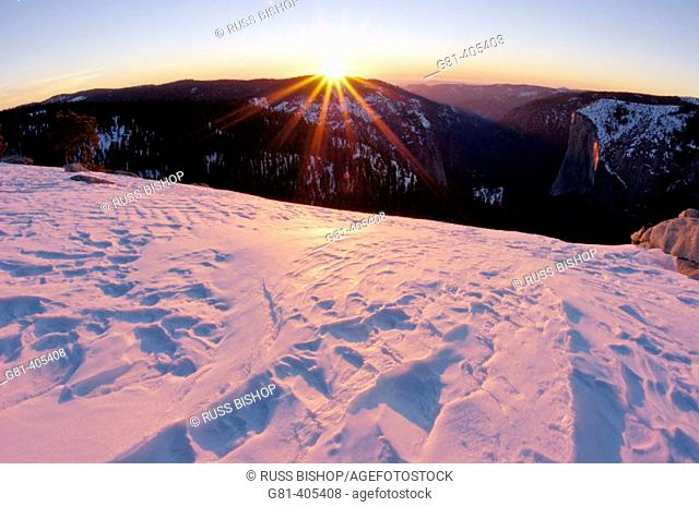 Sunset and windblown snow from the summit of Sentinel Dome, Yosemite National Park, California
