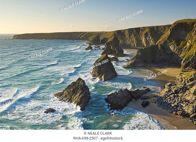 Evening light on the rock stacks, beach and rugged coastline at Bedruthan Steps, North Cornwall, England, United Kingdom, Europe