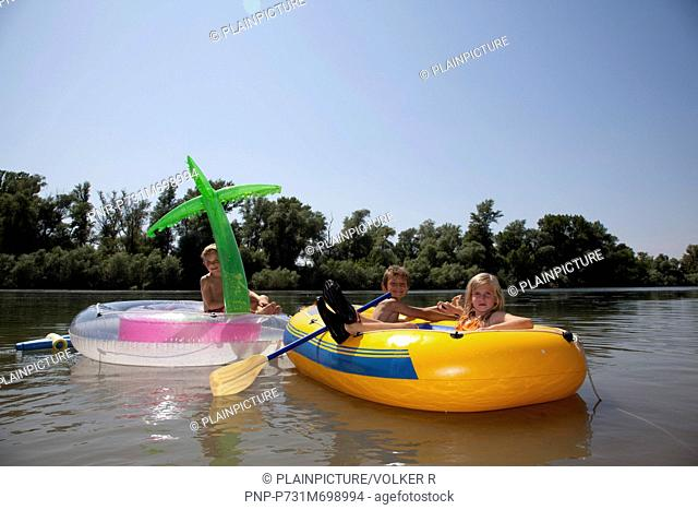 Children playing in rubber boat