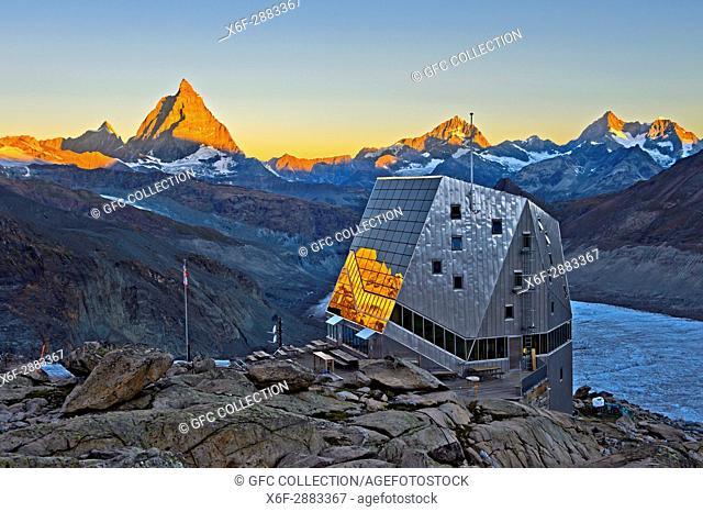 Dawn at the Monte Rosa Hut, Monte Rosa Hütte, above the glacier Gornergletscher, first sun rays at the top of the Matterhorn peak, Zermatt, Valais, Switzerland