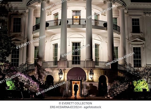 President Barack Obama enters the South Portico of the White House following his arrival aboard Marine One on the South Lawn, March 30, 2012