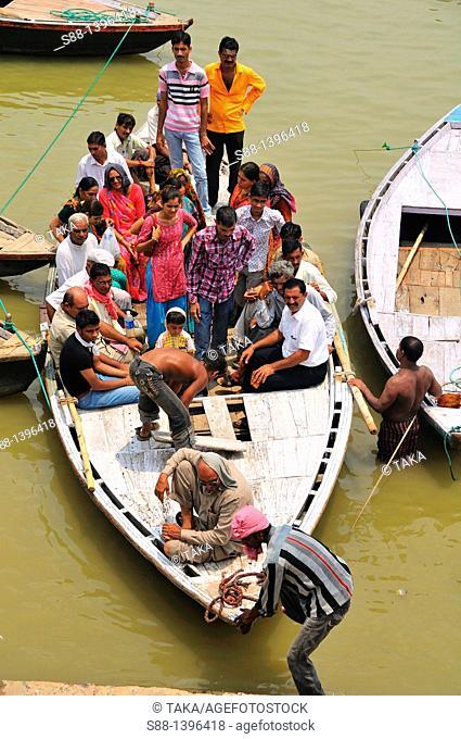 Pilgrims on the boat at Ganges river